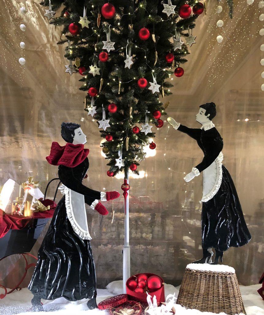Window decoration with upside down Christmas tree.